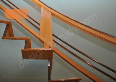 Red oak stairs with copper railing - side view 1