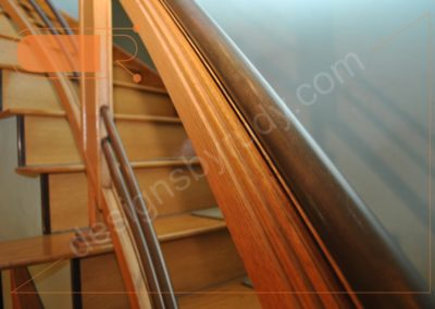 Red oak stairs with copper railing - side view 2