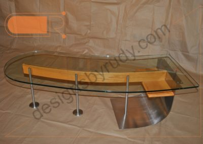 Unique coffee table made of stainless steel, wood, and glass in full left view, Designs by Rudy