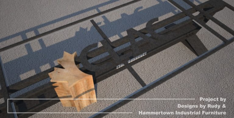 Steel, wood, and concrete conference room table designed by Designs by Rudy and handcrafted by Hammertown Industrial Furniture CLAC logo closeup