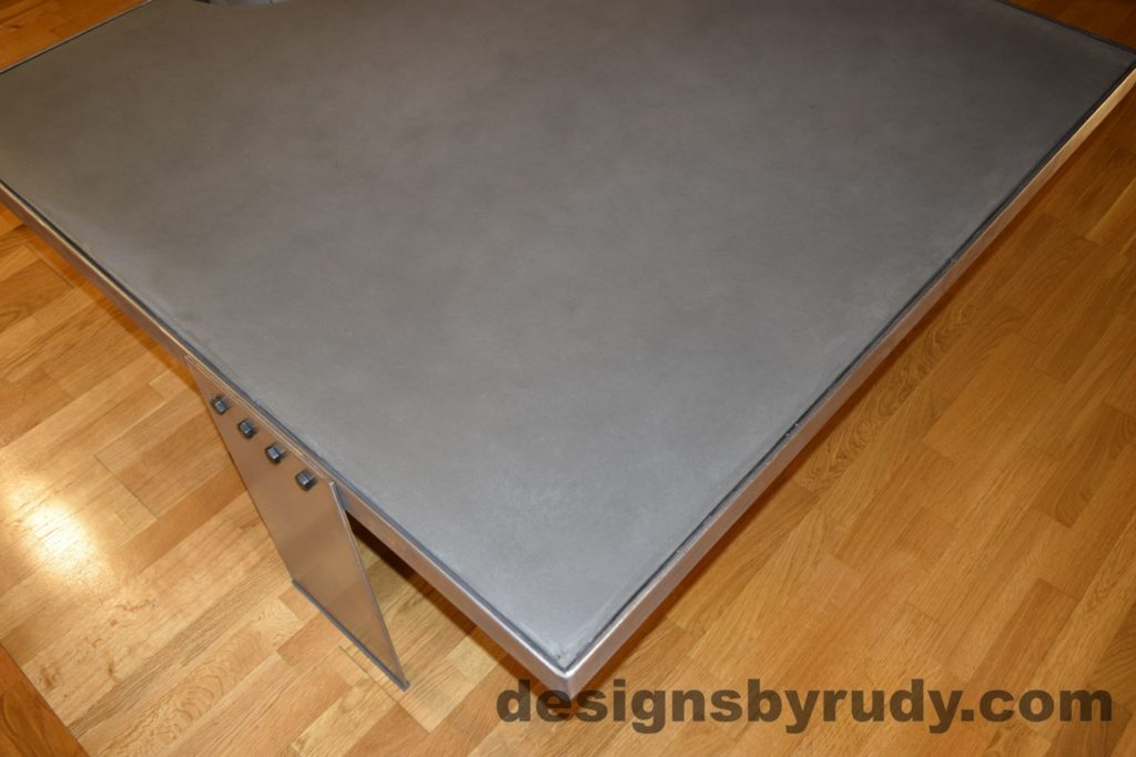 Gray Concrete Coffee Table, Polished Steel Frame, other side corner top view with flash