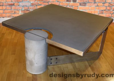 Gray Concrete Coffee Table, Polished Steel Frame, rear-supporting leg side view, with flash