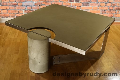 Gray Concrete Coffee Table, Polished Steel Frame, rear-supporting leg side view, no flash, Designs by Rudy