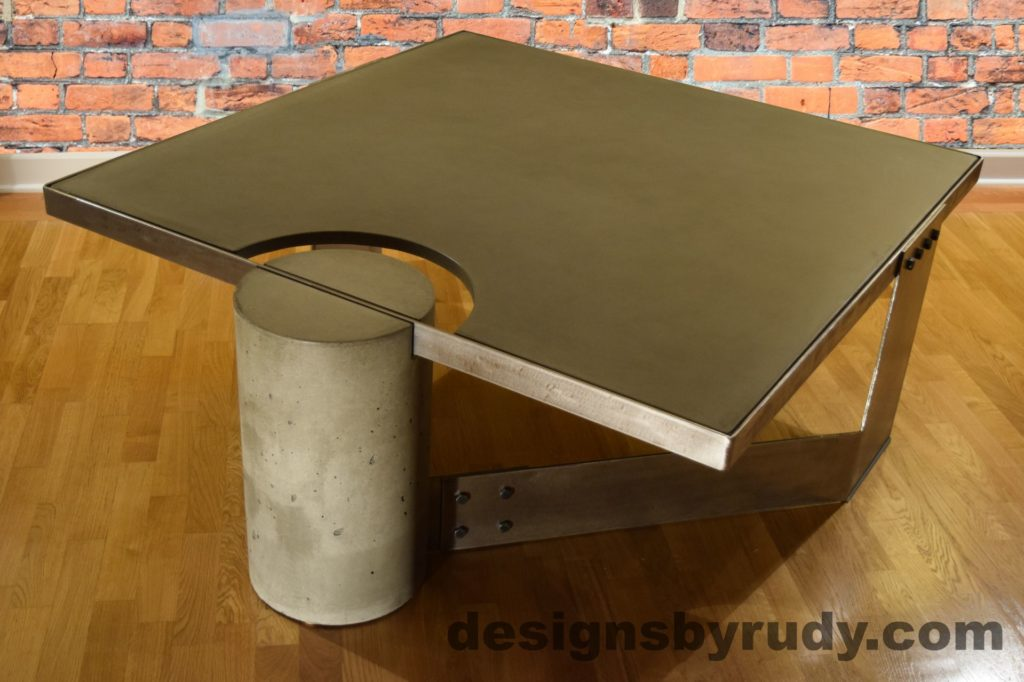 Gray Concrete Coffee Table, Polished Steel Frame, rear-supporting leg side view, no flash