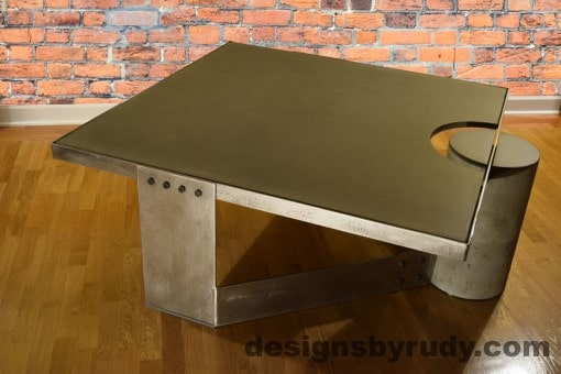 Gray Concrete Coffee Table, Polished Steel Frame, rear-supporting leg other side view 2, no flash, Designs ngs by Rudy