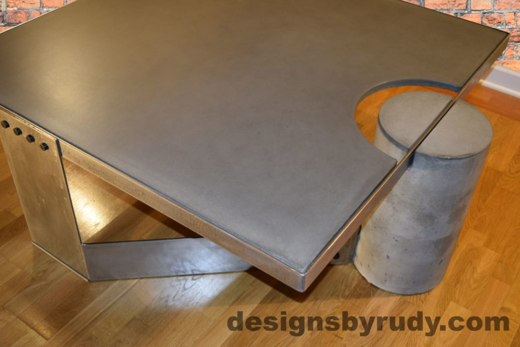 Gray Concrete Coffee Table, Polished Steel Frame, rear-supporting leg top corner view, with flash