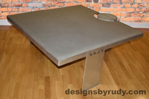Gray Concrete Coffee Table, Polished Steel Frame, side corner view with flash, Designs by Rudy