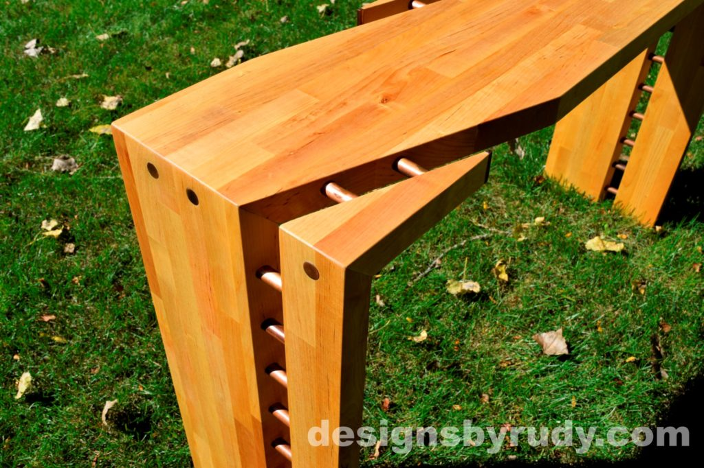 Butchered butcher block console table corner view closeup - exterior full sun Designs by Rudy for sale