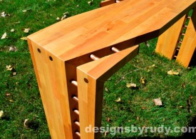 Butchered butcher block console table corner view closeup - exterior full sun Designs by Rudy