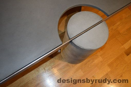 Gray Concrete Coffee Table, Polished Steel Frame, concrete leg and frame joint, top angle view 2, with flash, Designs by Rudy