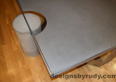 Gray Concrete Coffee Table, Polished Steel Frame, concrete leg and frame joint, top angle view, with flash, Designs by Rudy