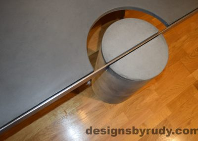 Gray Concrete Coffee Table, Polished Steel Frame, concrete leg and frame joint, top angle view 2, with flash