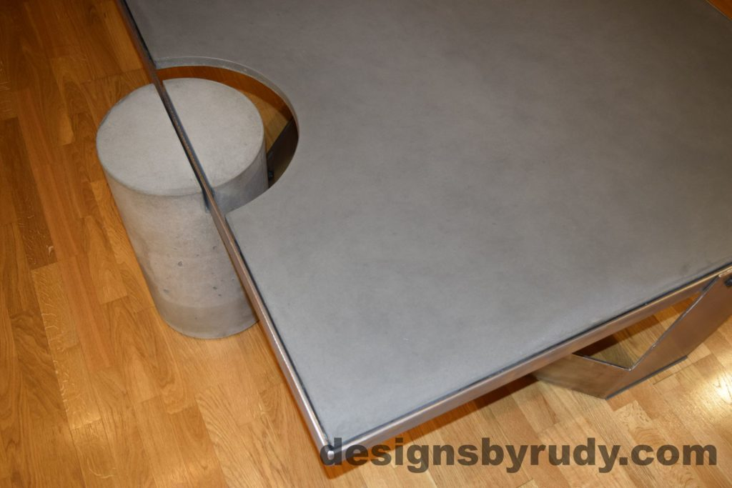 Gray Concrete Coffee Table, Polished Steel Frame, concrete leg and frame joint, top angle view, with flash