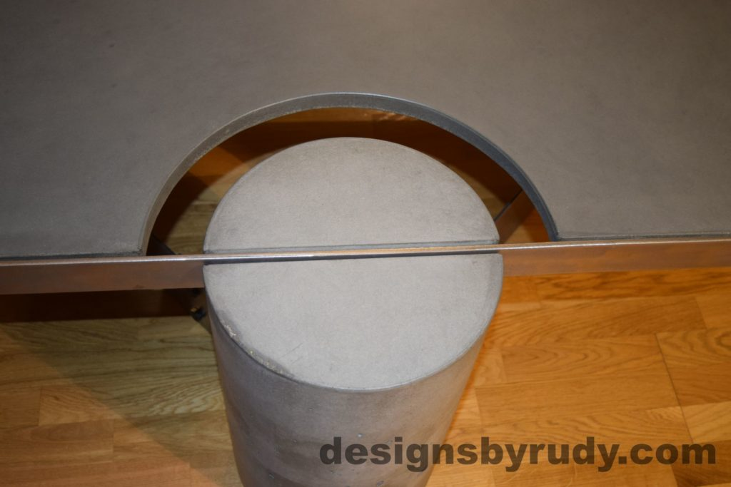Gray Concrete Coffee Table, Polished Steel Frame, concrete leg and frame joint, top straight view, with flash
