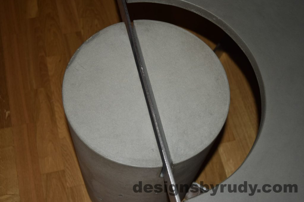 Gray Concrete Coffee Table, Polished Steel Frame, concrete leg and frame joint, top view with flash