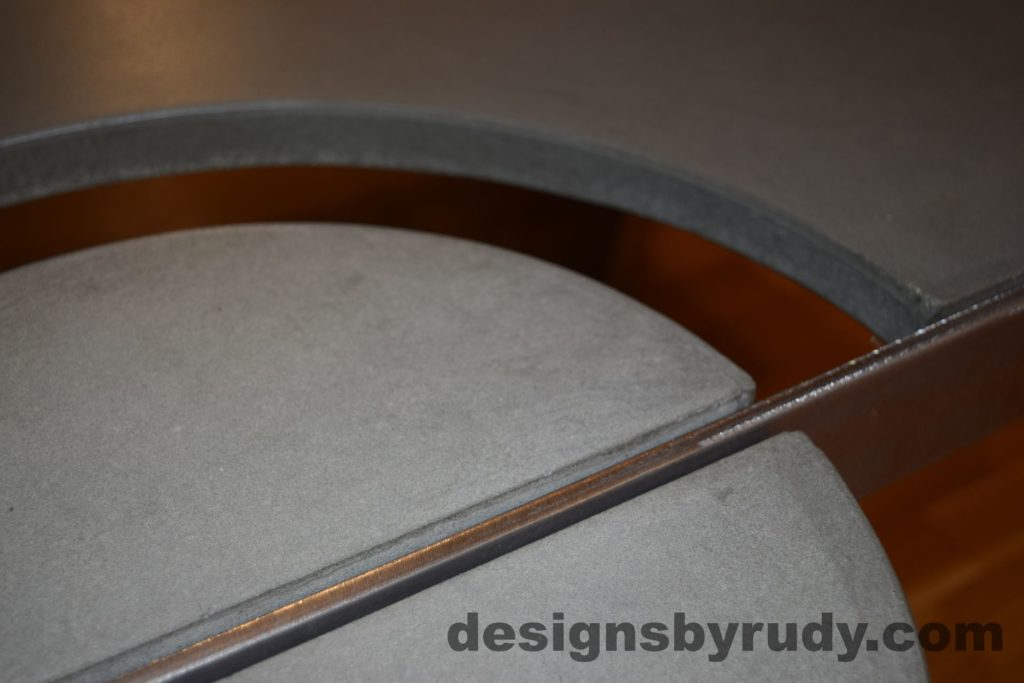 Gray Concrete Coffee Table, Polished Steel Frame, concrete leg and frame joint, with flash