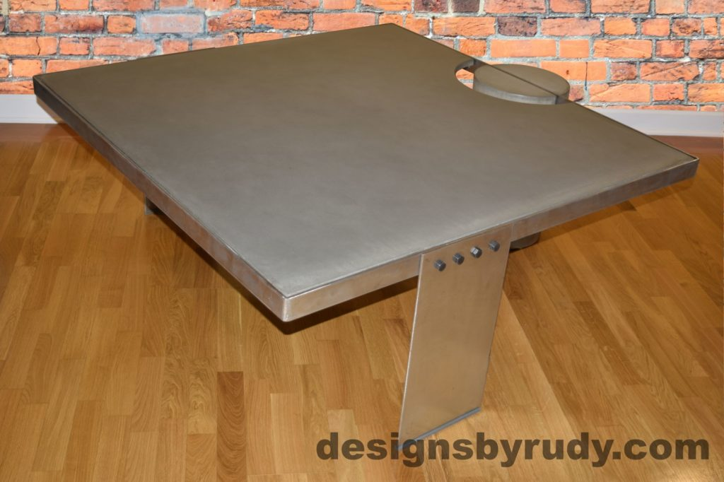 Gray Concrete Coffee Table, Polished Steel Frame, side corner view with flash