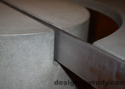 Gray Concrete Coffee Table, Polished Steel Frame, concrete leg and frame joint closeup, Designs by Rudy