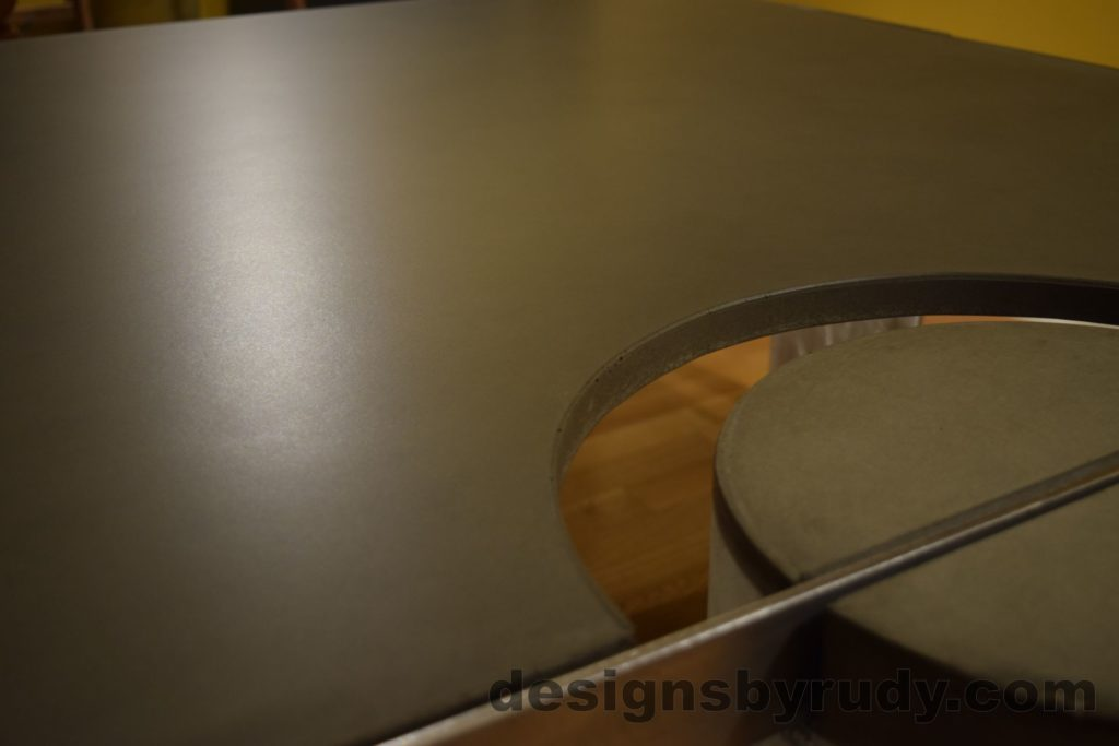 Gray Concrete Coffee Table, Polished Steel Frame, top, concrete leg and frame joint no flash