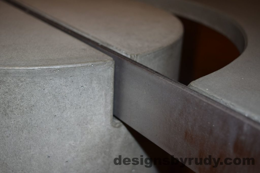 Gray Concrete Coffee Table, Polished Steel Frame, concrete leg and frame joint closeup