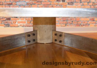 Gray Concrete Coffee Table, Polished Steel Frame, supporting leg joints closeup view 2 no flash, Designs by Rudy
