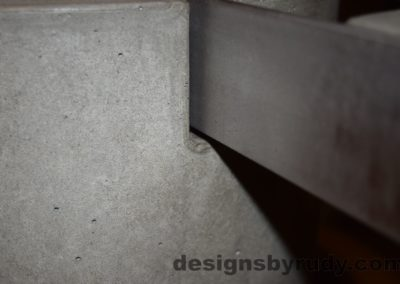 Gray Concrete Coffee Table, Polished Steel Frame, concrete leg and frame joint closeup 2