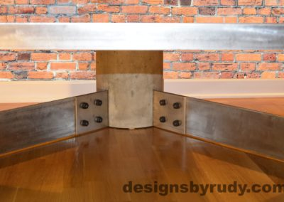 Gray Concrete Coffee Table, Polished Steel Frame, supporting leg joints closeup view 2 no flash