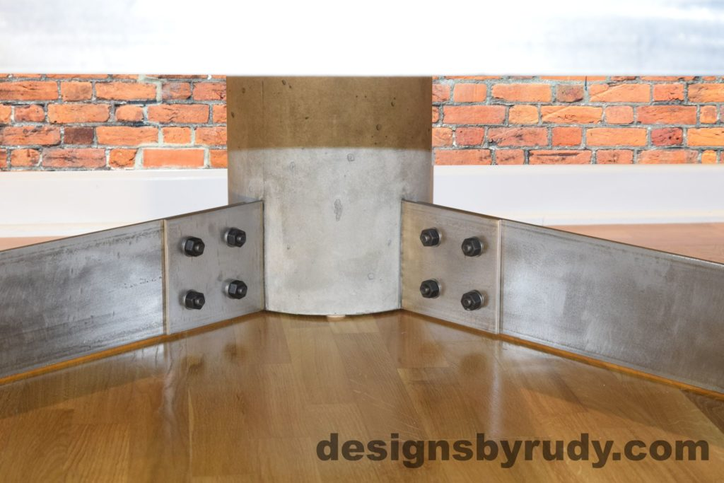 Gray Concrete Coffee Table, Polished Steel Frame, supporting leg joints closeup view 2 with flash