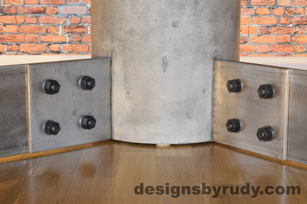 Gray Concrete Coffee Table, Polished Steel Frame, supporting leg joints closeup view with flash