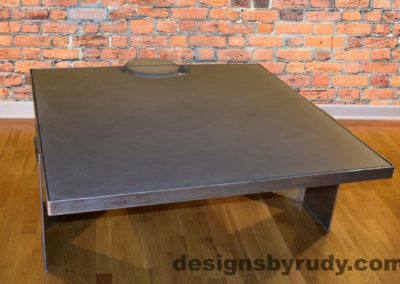Gray Concrete Coffee Table, Polished Steel Frame, front side corner with flash