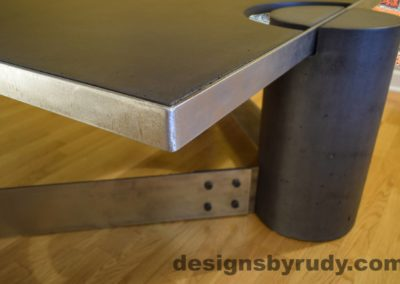 Black Concrete Coffee Table, Polished Steel Frame, frame corner and leg side view closeup, no flash Designs by Rudy