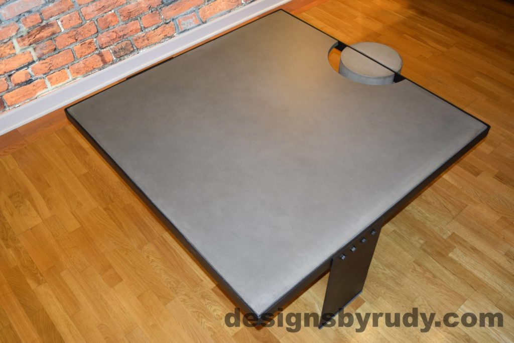 Gray Concrete Coffee Table, Black Steel Frame, top angle view 3, Designs by Rudy