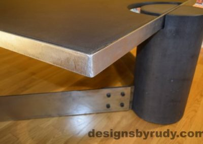 Charcoal Concrete Coffee Table, Polished Steel Frame, frame corner and leg side view closeup, with flash Designs by Rudy