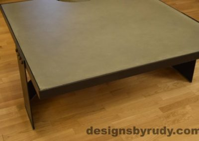 Gray Concrete Coffee Table, Black Steel Frame, corner front view, no flash, Designs by Rudy