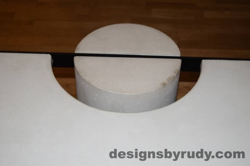 White Concrete Coffee Table, Black Steel Frame, concrete leg and steel frame joint top view 6, Designs by Rudy
