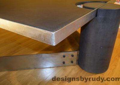 Black Concrete Coffee Table, Polished Steel Frame, frame corner and leg side view closeup, with flash Designs by Rudy