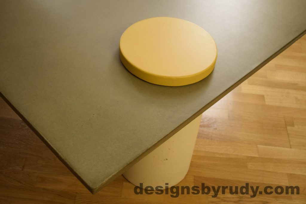 11L Gray Concrete Coffee Table, White Pillar and Yellow Cap closeup no flash, Designs by Rudy DR18