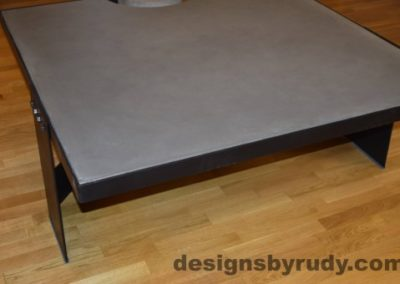 Gray Concrete Coffee Table, Black Steel Frame, corner front view, with flash, Designs by Rudy