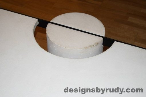 White Concrete Coffee Table, Black Steel Frame, concrete leg and steel frame joint top view 5, Designs by Rudy