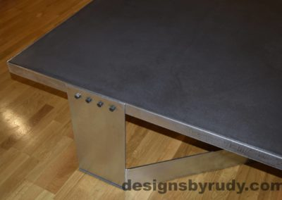 Black Concrete Coffee Table, Polished Steel Frame, steel leg view, with flash Designs by Rudy