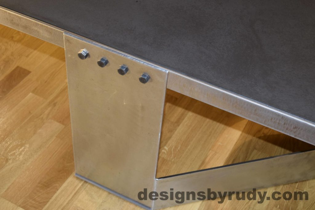Black Concrete Coffee Table, Polished Steel Frame, steel leg view closeup, with flash Designs by Rudy