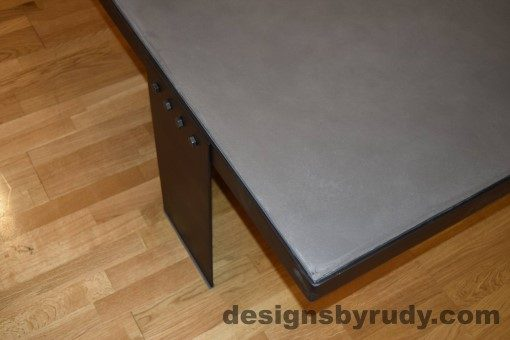 Gray Concrete Coffee Table, Black Steel Frame, top front corner view, with flash, Designs by Rudy