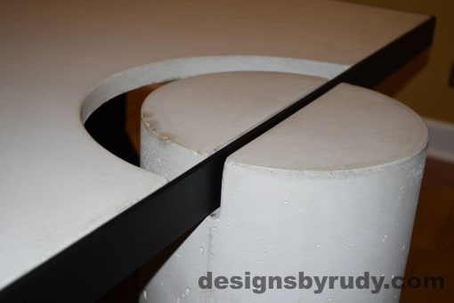 White Concrete Coffee Table, Black Steel Frame, concrete leg and steel frame joint top view detail 2, Designs by Rudy