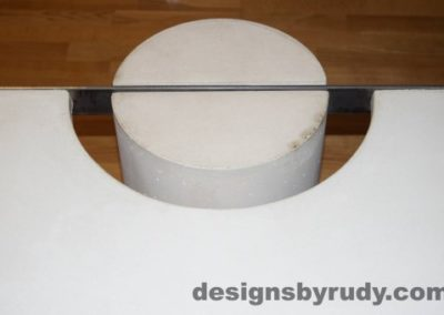 14 White Concrete Coffee Table, Polished Steel Frame, round leg top view closeup 9 with flash Designs by Rudy
