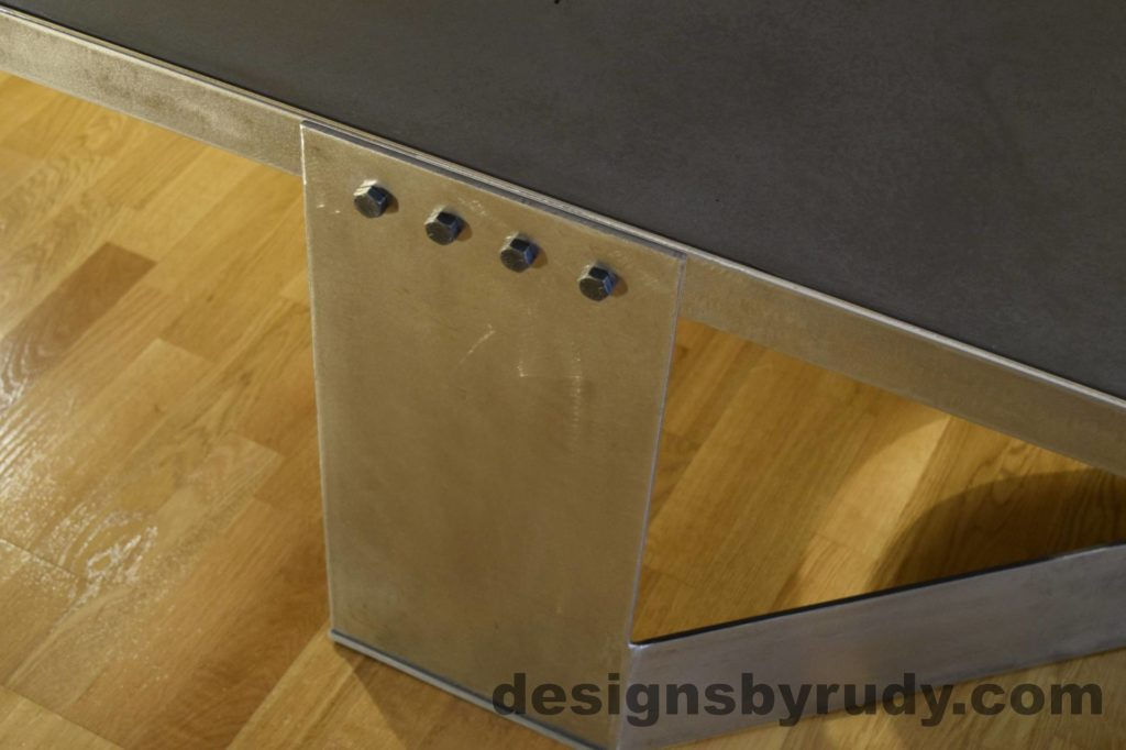 Black Concrete Coffee Table, Polished Steel Frame, steel leg view closeup, no flash Designs by Rudy