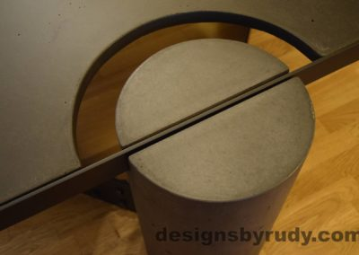 Black Concrete Coffee Table, Black Steel Frame, round leg top angle view 2, no flash, Designs by Rudy