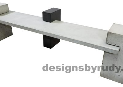 DR CB1 concrete bench on 3 pedestals by Designs by Rudy, right angle view, slab and 2 large pedestals in gray concrete, center pedestal in charcoal