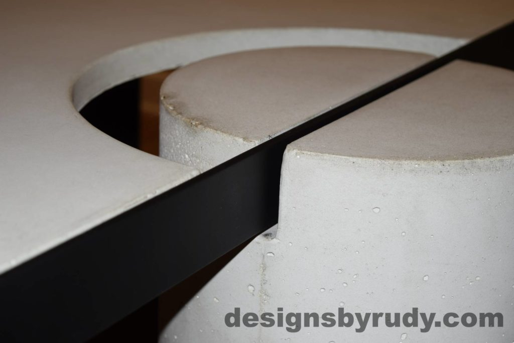 White Concrete Coffee Table, Black Steel Frame, concrete leg and steel frame joint top view detail 3, Designs by Rudy