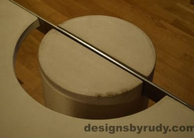 18 White Concrete Coffee Table, Polished Steel Frame, round leg top view closeup 5 with flash Designs by Rudy