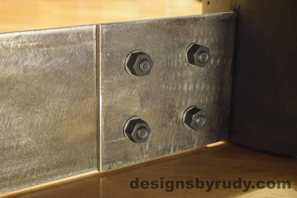 Black Concrete Coffee Table, Polished Steel Frame, steel leg and concrete leg joint closeup, Designs by Rudy